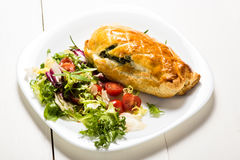 Chicken breast stuffed spinach in puff pastry Royalty Free Stock Photo
