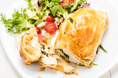 Chicken breast stuffed spinach in puff pastry Royalty Free Stock Image