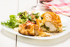 Chicken breast stuffed spinach in puff pastry Stock Images