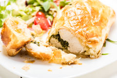 Chicken breast stuffed spinach in puff pastry Stock Photography