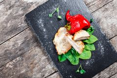 Free Chicken Breast Stuffed With Cheese And Ham With Spinach And Sweet Pepper On Stone Slate Background Royalty Free Stock Photo - 134048035