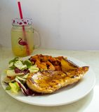 Chicken breast with sweet potato and salad. In this picture you can see the white of the background as well as the plate. On it can be seen the golden colours of royalty free stock photo