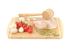 Chicken breast and vegetables with meat mallet. Stock Photography
