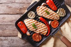 Chicken breast with vegetables in pan grill horizontal top view Stock Photos