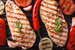 Chicken breast with vegetables in a skillet grill top view macro Stock Photography