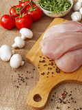 Chicken breast with vegetables. On a wooden Board Royalty Free Stock Photos