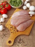 Chicken breast with vegetables. On a wooden Board Stock Images
