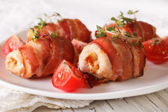 Chicken breast wrapped in bacon close-up. horizontal Stock Photos