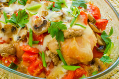 Chicken breasts baked with tomatoes and mushrooms Stock Photos