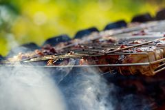 chicken breasts cook on the barbque grill stock images