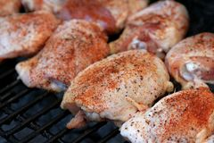 Chicken breasts cooking on a grill Stock Photo