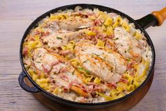 Chicken breasts with creamy bacon and mushroom pasta. royalty free stock photos