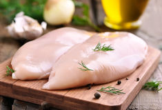 Chicken breasts on cutting board Stock Photos
