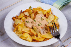 Chicken breasts in mushroom creamy sauce and home fried potatoes. Royalty Free Stock Photos