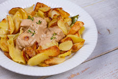 Chicken breasts in mushroom creamy sauce and home fried potatoes. Stock Image
