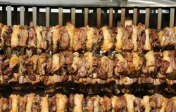 Chicken breasts roast on a spit. At a festival royalty free stock image