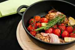 Chicken breasts with rosemary and tomatoes Royalty Free Stock Images