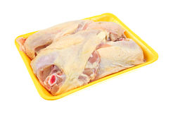 Chicken breasts on a yellow butchers tray Royalty Free Stock Photos