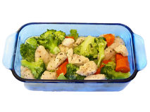 Chicken & broccoli & carrot stir-fry in butter Royalty Free Stock Photos