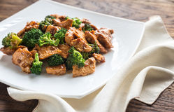 Chicken with broccoli. Portion of chicken with broccoli on the wooden table Stock Photos