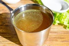 Chicken broth, bouillon, clear soup. Stock Photo