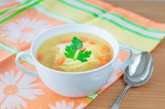 Chicken broth with carrot and parsley. Royalty Free Stock Photos