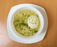 Chicken broth with dill and egg. Royalty Free Stock Images