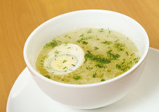 Chicken broth with dill and egg. Royalty Free Stock Photos