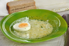 Chicken broth with egg and dill Stock Photo
