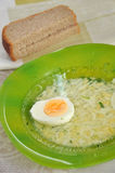 Chicken broth with egg and dill Royalty Free Stock Photography