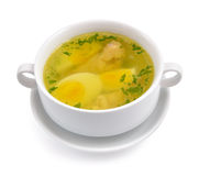 Chicken broth with egg and greens. Stock Image