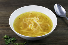Chicken broth with noodles. And parsley leaves. Traditional polish soup Royalty Free Stock Image