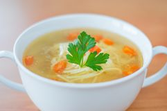 Chicken broth with nudles, carrot and and parsley. Royalty Free Stock Photos