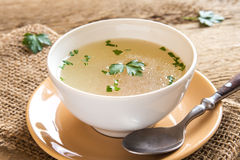 Chicken broth with parsley Stock Photos