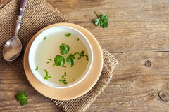 Chicken broth with parsley Royalty Free Stock Photography