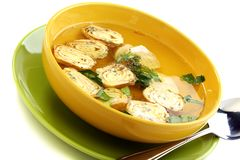 Chicken broth with rolls of omelet. Royalty Free Stock Image