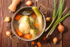 Chicken broth soup. On wood royalty free stock photography