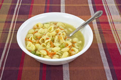 Chicken broth soup with spoon Stock Photos