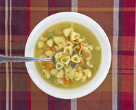 Chicken broth soup with spoon Royalty Free Stock Photography