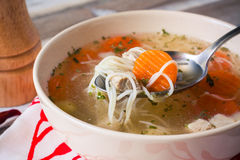 Chicken broth on a spoon Royalty Free Stock Photo