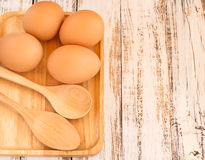 Chicken brown eggs on wooden background Royalty Free Stock Images