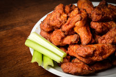 Chicken Buffalo Wings. With Celery Sticks royalty free stock photography