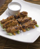 Chicken buffalo wings on plate stock photos