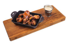 Chicken Buffalo Wings with sauce on wooden board Stock Photo