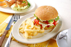 Chicken Burger. With mayonnaise and katchup in a saucers Stock Photo