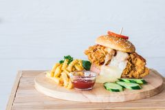 The Chicken burger cheese white  French fries placed on wood dish Royalty Free Stock Photo
