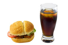 Chicken Sandwich and Drink, Isolated. Fried chicken sandwich with lettuce and tomato and cola beverage with ice, isolated stock images