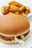 Chicken burger and home fries Stock Photo