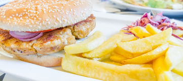Chicken burger with potatoes Stock Image