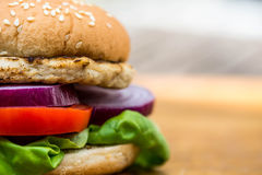 Chicken Burger or Sandwich in a Sesame Bread Roll Royalty Free Stock Photos